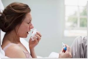 woman sick in bed flu cold_thumb[1